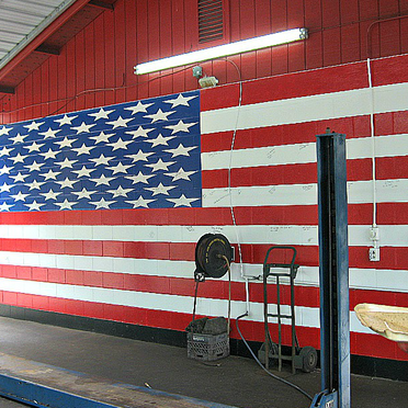 An American flag painted on a wall inside of transmission repair shop Best Transmission in Jacksonville, FL
